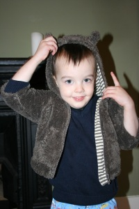 boy wearing baby coat