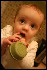 baby with measuring cup