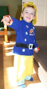 Boy dressed in fireman sam outfit