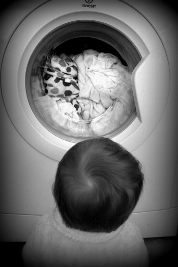 baby watching washing machine