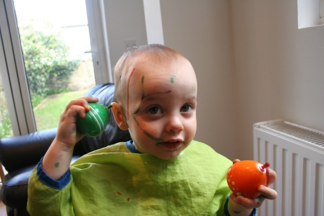 child painting his face
