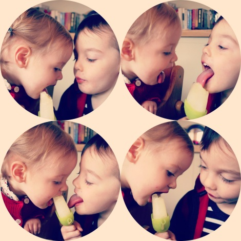 siblings sharing an ice cream