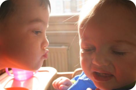 brother trying to kiss his sister
