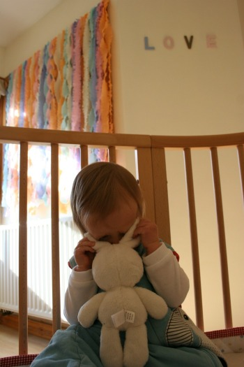 girl hiding behing her bunny