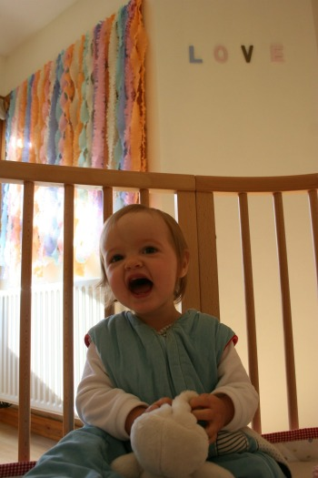 girl in her cot smiling