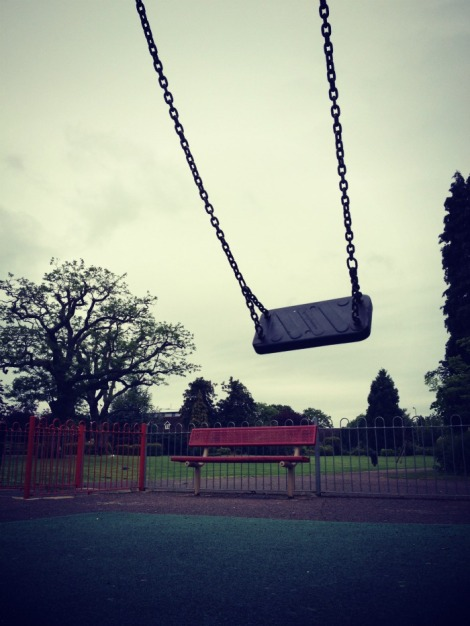 empty swing in childrens playgroun