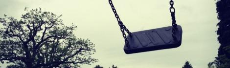 empty swing in childrens playgroun