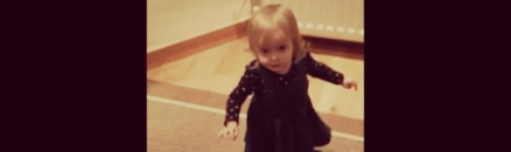 girl taking first steps