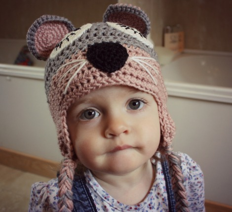 girl in a crocheted mouse hat