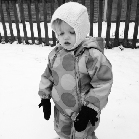 toddler unimpressed with snow