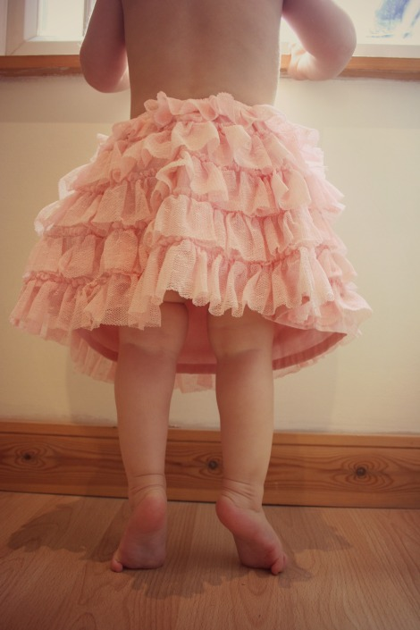 toddler in tutu on tippytoes