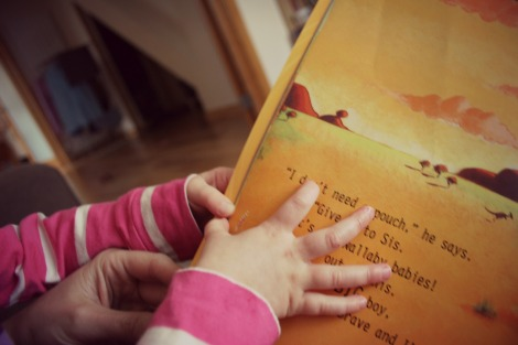 Little fingers opening a book
