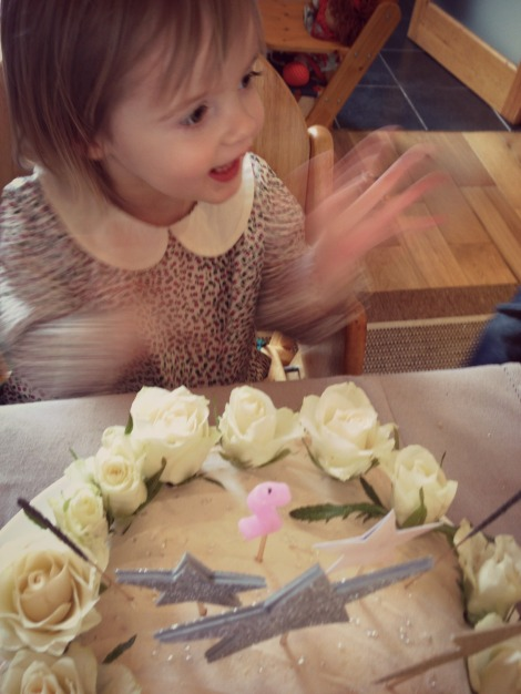 birthday girl clapping after blowing out candles
