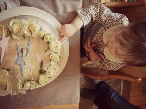 girl touching her cake