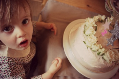 girl with her 2nd birthday cake