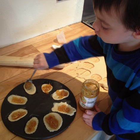 boy filling jam tarts
