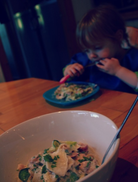 bowl of courgette and celeriac 'pasta' carbonara and toddler eating it