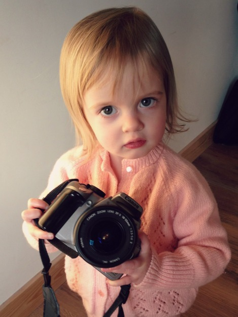 toddler with a camera