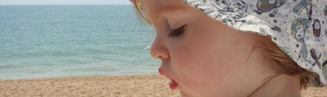 Girl in sunhat on beach