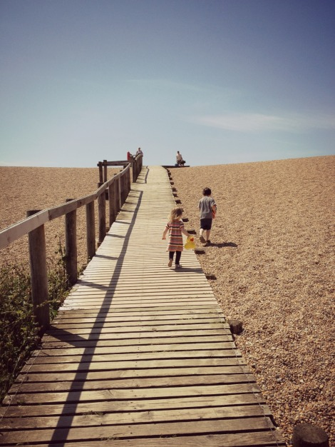 Children walking up Chesil Beach