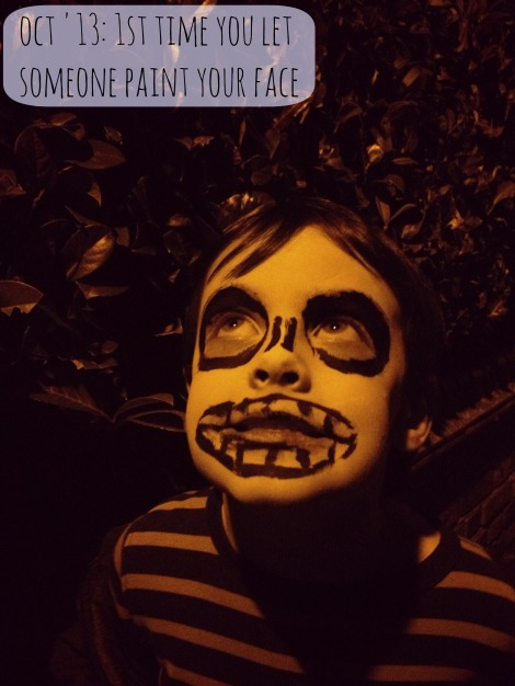 boy with face painted for Halloween