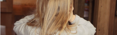 girl covering her ears