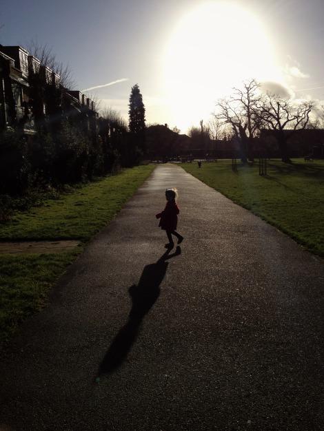 girl running in the park in winter