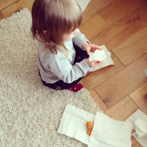 girl playing with tissues