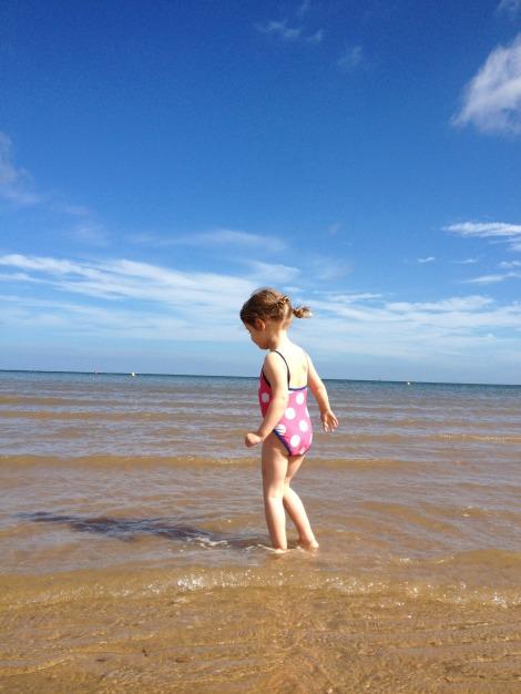girl in water on beach | bluebirdsunshine