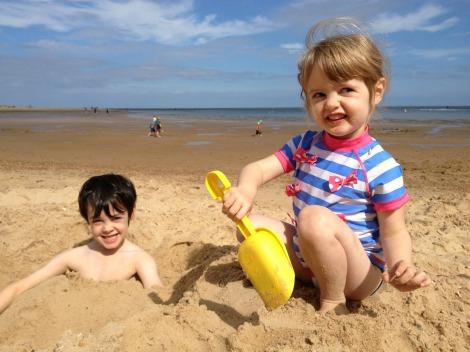 Brother and sister on the beach | bluebirdsunshine
